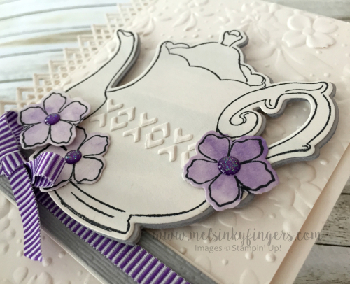 An ink wash, pieces from the Delicate Lace edgelit dies, and the flowers from the Tea Time die set add perfect details.